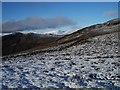 NN9363 : Snowy hillside by Lis Burke