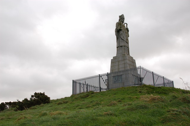 A statue of St. Patrick in the valleys of Ireland.