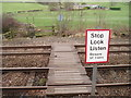 NY6664 : Pedestrian level crossing at Blenkinsopp by Tim Fish