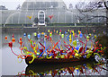 TQ1877 : Chihuly glass in boat, morning, Palm House by Eric Baker