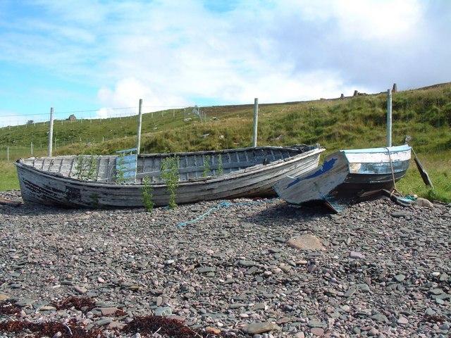 Old fishing boats below derelict croft at Badenscallie
