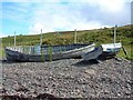 NC0305 : Old fishing boats below derelict croft at Badenscallie by C Page