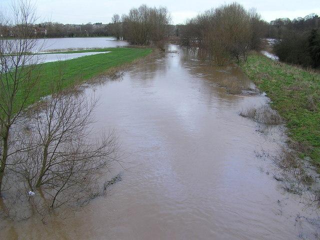 River Penk in flood north of bridge at Radford Bank
