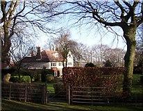 SE1421 : House off Huddersfield Road, Rastrick by Humphrey Bolton