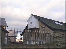 SE1421 : Unusual structure on garage, Shepherds Thorn Lane, Rastrick by Humphrey Bolton