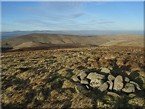 NN8902 : Cairn, Ben Buck slopes by Andrew Smith