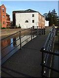 SX9291 : Footbridge beside Trews Weir by Derek Harper