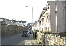 SH4862 : Beneath the barrack wall by Eric Jones