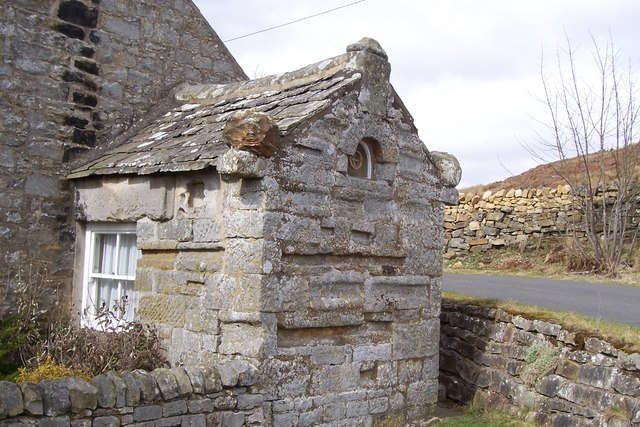 Old schoolhouse porch made from Roman stones brought from the fort at Bremenium