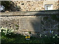 NZ1616 : Memorial stone in the wall of St Mary's churchyard by Stanley Howe