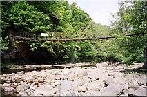 NY7962 : Footbridge at Plankey Mill by Julia Thompson