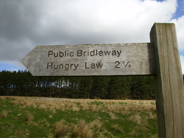 Bridleway to Hungry Law (501m) sign by the A68 road