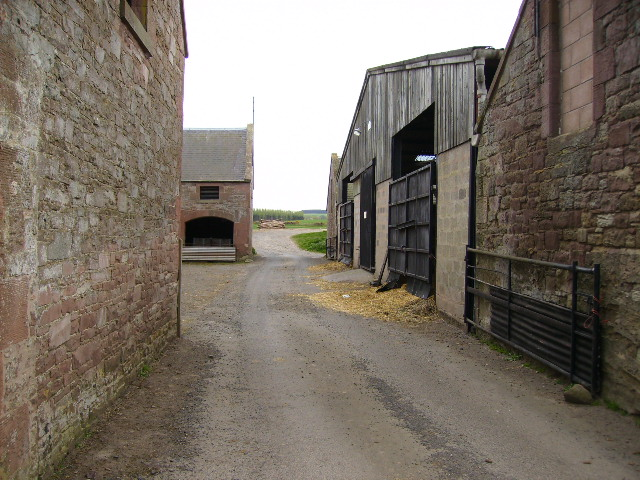 Tarmac track through farm buildings at Easter Wooden