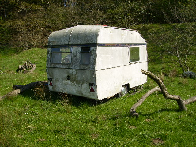 Derelict caravan near the man made pond at Soulby Wood