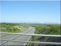 SH4473 : An empty A55(T) from a crawling bus on a congested A5114 by Eric Jones