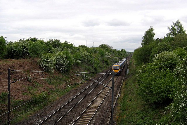 London Train approaching Littleburn Farm Railway Bridge