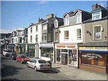 SH5638 : Shops opposite the Porthmadog bus station by Eric Jones
