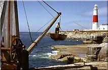 SY6768 : Boat Crane & Portland Bill Lighthouse by John Wray