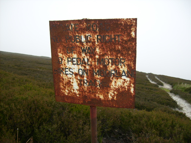 Close up view of rusty sign