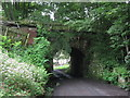 NY8261 : Old railway bridge over the approach road to Langley Garden Station by Mike Quinn