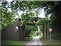 TG2533 : Railway bridge as you enter Antingham by Zorba the Geek