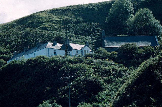 Old Coastguard Cottages, and Burnmouth Parish Church, from Partanhall
