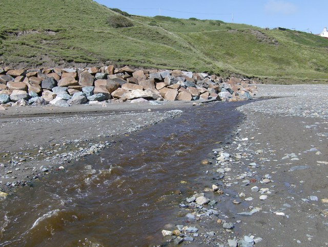 Afon Daron running across Aberdaron beach at low tide