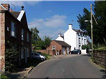 SJ9743 : Houses Near Dilhorne Church by Geoff Pick