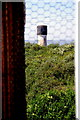 TA4011 : View of one lighthouse from inside the other by Charles Rispin