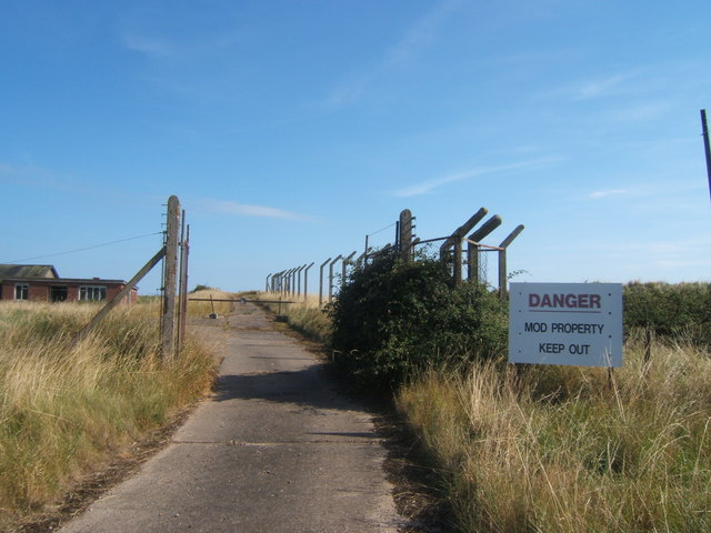 Track and obsolete warning sign, Orford Ness
