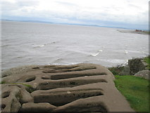 SD4061 : Stonecut graves at St Patrick's Chapel by ian saunders