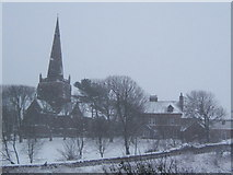 SD1779 : Millom church during a snow fall by Andrew Hill