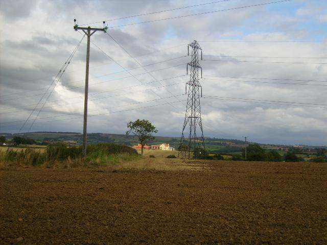 Oxfield Farm framed by electric pylon lines