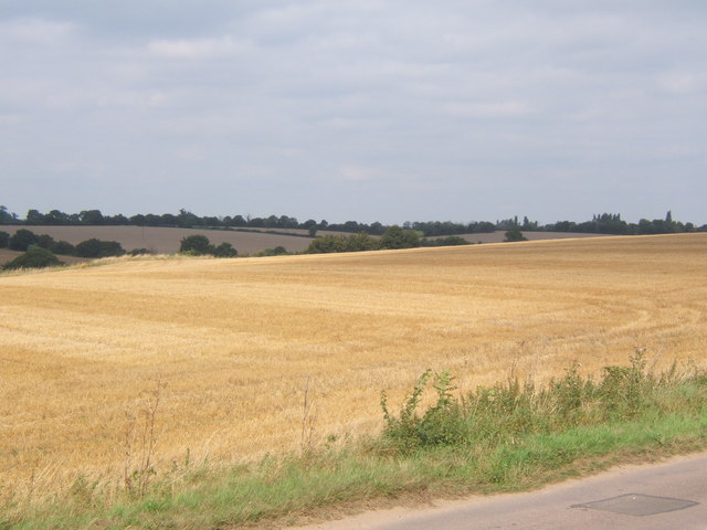 Large field by lane close to Hemingstone Church