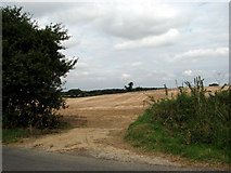 TG2815 : View north across stubble from Stonehouse Road by Evelyn Simak