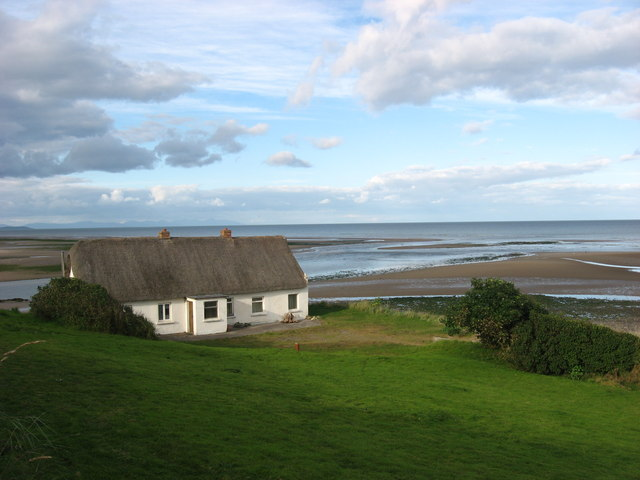 Thatched house and River Nanny at Corballis