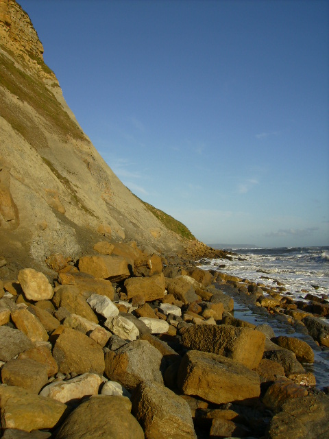 Rocky coastline under the cliff at Cunstone Nab