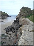 SX0080 : Old harbour wall at Port Gaverne by Trevor Rickard