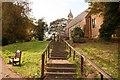 SK6544 : Churchyard steps by Richard Croft