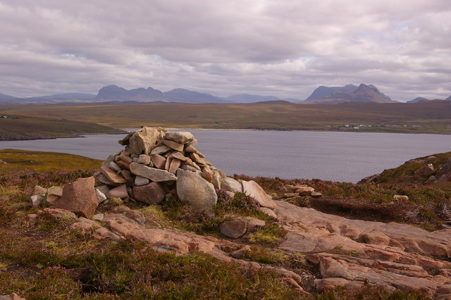 Cairn on summit at north end of Tanera More, with Assynt hills behind