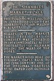 NY9364 : The Shambles, Market Place - explanatory plaque by Mike Quinn