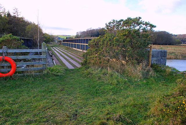 Disused railway bridge over the river Leven