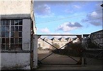 SW6439 : Derelict industrial buildings opposite Camborne station by Tom Jolliffe