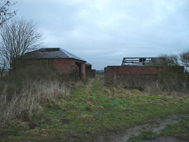 Derelict farm buildings on Haugh Rigg Road