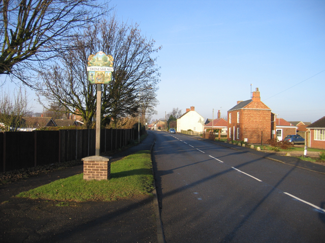 Millennium village sign in South Street, Swineshead, Lincs