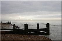 TQ1602 : Groynes on Worthing Beach, West Sussex by Roger  Kidd