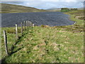 NN6967 : Fenceline and Loch Con by Calum McRoberts