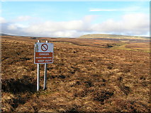 NY8221 : Warcop Range warning sign on Lune Head Moss by Mick Borroff