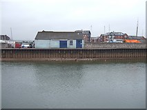SX9291 : Quayside office, Exeter, and river with low flow by David Smith
