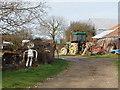SX2194 : Lower Exe farmyard with tin man by David Hawgood